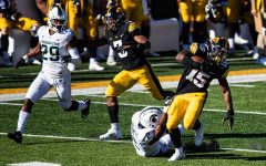Iowa running back Tyler Goodson carries the ball during a football game between Iowa and Michigan State in Kinnick Stadium on Saturday, Nov. 7, 2020. The Hawkeyes dominated the Spartans, 49-7. Goodson and fellow back Mekhi Sargent each ran for 2 scores.