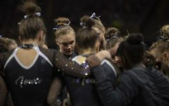 Iowa's all-around Allyson Steffensmeier huddles with her teammates during a gymnastics meet at Carver Hawkeye Arena against Michigan State on Saturday, Feb. 1, 2020. The Hawkeyes won three out of four events against the Spartans with a score, 195.450-195.275.