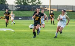 Iowa forward Devin Burns runs down the ball during a women's soccer match between Iowa and Western Michigan on Thursday, August 22, 2019. The Hawkeyes defeated the Broncos, 2-0.