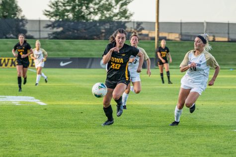 Iowa forward Devin Burns runs down the ball during a women