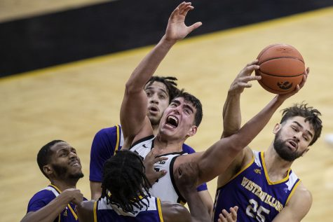 Iowa Center Luka Garza fights for a rebound during the Iowa v. Western Illinois basketball game in Carver-Hawkeye Arena on Thursday, Dec. 3, 2020. Iowa defeated Western Illinois with a final score of 99-58.
