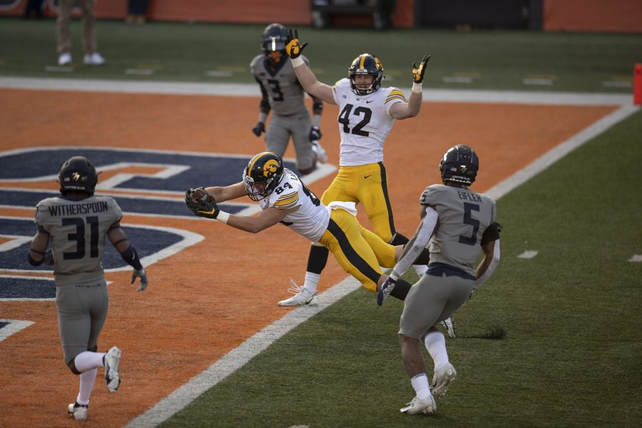 Iowa tight end Sam LaPorta (84) scores Iowa's first touchdown of the game during the second quarter of the Iowa v. Illinois football game at Memorial Stadium on Saturday, Dec. 5, 2020.