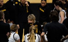 Lisa Bluder, head coach of the women's basketball team at Iowa, talks to the team during a time out at the game between Iowa and Iowa State at Carver-Hawkeye Arena on Wednesday, Dec. 9,2020. The Hawkeyes defeated the Cyclones in a close game, 82-80.