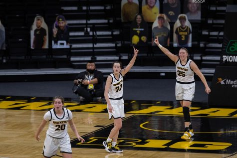 Iowa Guards Kate Martin (left), Caitlin Clark (middle), and Monika Czinano signal to their teammates during a women's basketball game between Iowa and Iowa State at Carver-Hawkeye Arena on Wednesday, Dec. 9,2020. The Hawkeyes defeated the Cyclones in a close game, 82-80.