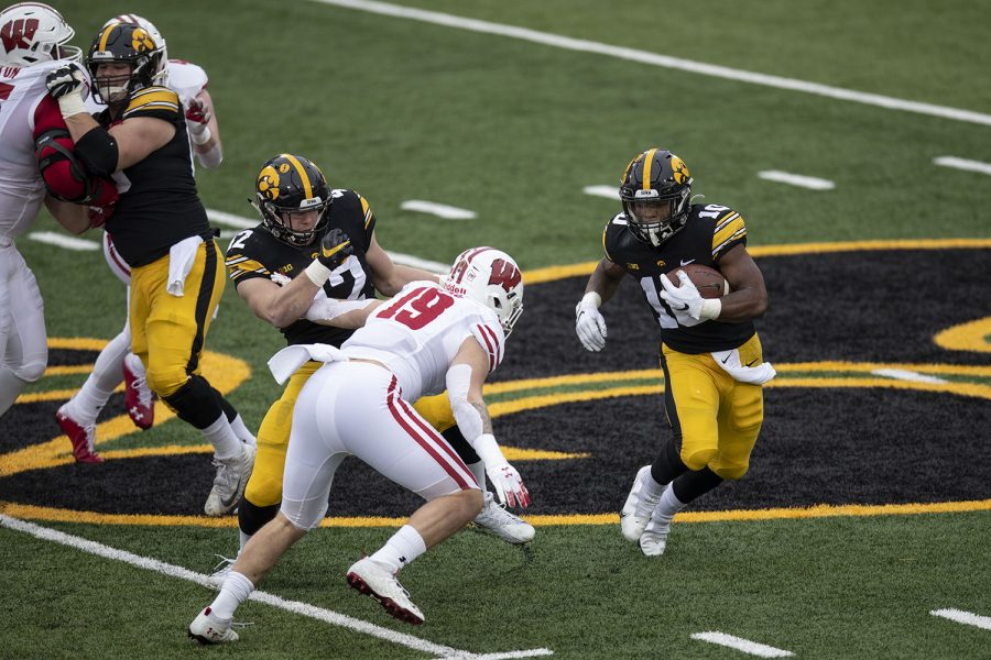 Dec. 12, 2020; Iowa City, Iowa, USA; Iowa running back Mekhi Sargent (10) moves the ball upfield during the first quarter of the Iowa v. Wisconsin football game at Kinnick Stadium. Iowa defeated Wisconsin with a score of 28-7. Mandatory Credit: