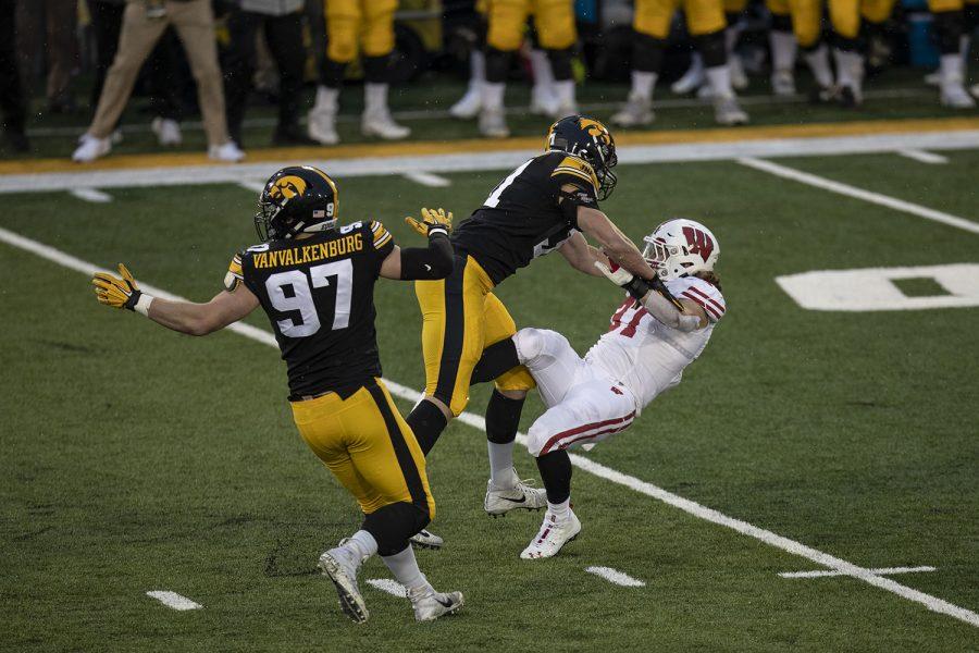 Dec. 12, 2020; Iowa City, Iowa, USA; Iowa linebacker Jack Campbell tackles Wisconsin running back Garrett Groshek during the second quarter of the Iowa v. Wisconsin football game at Kinnick Stadium. Iowa defeated Wisconsin with a score of 28-7.