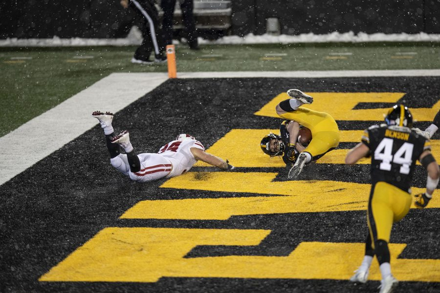 Dec. 12, 2020; Iowa City, Iowa, USA; Iowa linebacker Jack Campbell (31) catches an interception during the fourth quarter of the Iowa v. Wisconsin football game at Kinnick Stadium. Iowa defeated Wisconsin with a score of 28-7.
