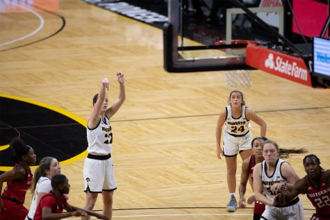 Iowa guard Caitlin Clark attempts a free throw at Carver-Hawkeye Arena on December 31 2020.
