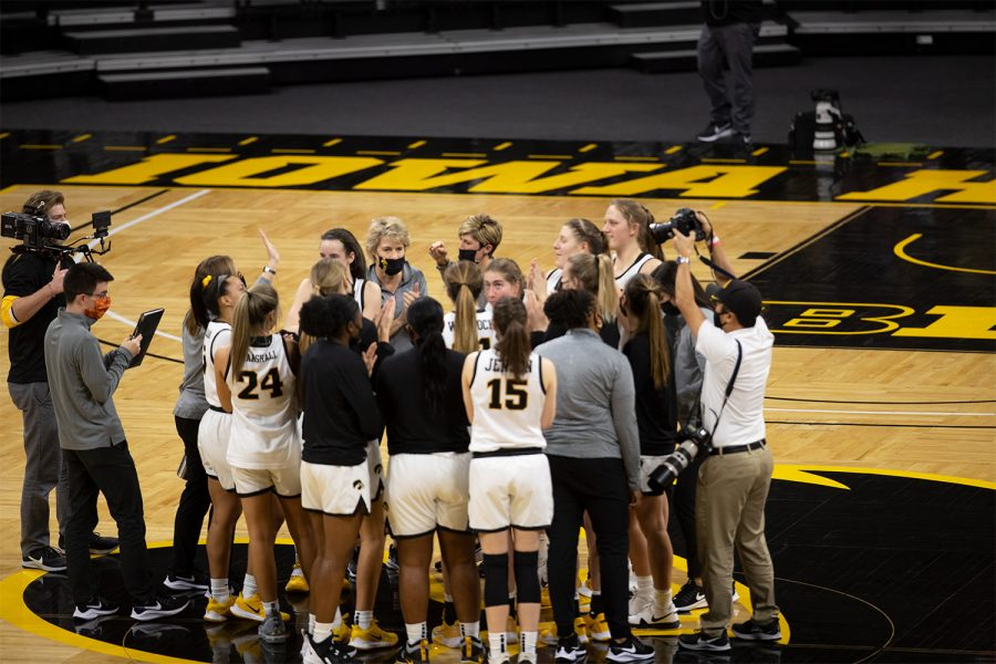 The Iowa women's basketball team gathers to the middle of the court after they beat Rutgers 90-84 at Carver-Hawkeye Arena on December 31 2020.