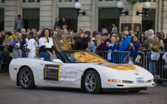 Grand Marshal B.J. Armstrong rides in a Corvette during the 2019 Homecoming Parade on Oct. 18 in Downtown Iowa City.