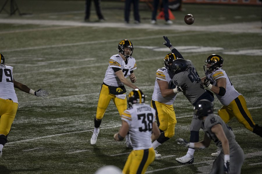 Iowa quarterback Spencer Petras (7) throws a pass during the third quarter of the Iowa v. Illinois football game at Memorial Stadium on Saturday, Dec. 5, 2020. Iowa defeated Illinois with a final score of 35-21.