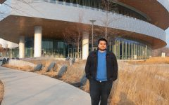 """Author Jesus """"Chuy"""" Renteria standing in front of Hancher Auditorium is seen on December 6 2020. Renteria and Associate Professor Christine Shea will attend Obermann Around The Table to talk about their bilingual experiences and bilingualism in Iowa as a whole."""