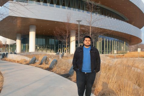 "Author Jesus ""Chuy"" Renteria standing in front of Hancher Auditorium is seen on December 6 2020. Renteria and Associate Professor Christine Shea will attend Obermann Around The Table to talk about their bilingual experiences and bilingualism in Iowa as a whole."