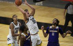 Iowa Center Luka Garza goes in for a basket during the Iowa v. Western Illinois basketball game in Carver-Hawkeye Arena on Thursday, Dec. 3, 2020. Iowa defeated Western Illinois with a final score of 99-58. Garza scored a total of 35 points.