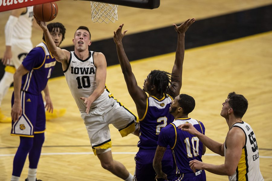 Iowa Forward Joe Wieskamp jumps for a basket during the Iowa v. Western Illinois basketball game in Carver-Hawkeye Arena on Thursday, Dec. 3, 2020. Iowa defeated Western Illinois with a final score of 99-58.