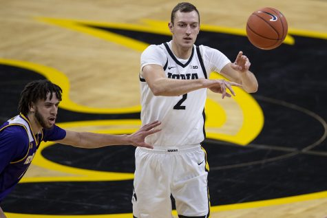 Iowa forward Jack Nunge throws the ball to a teammate during the Iowa v. Western Illinois basketball game in Carver-Hawkeye Arena on Thursday, Dec. 3, 2020. Iowa defeated Western Illinois with a final score of 99-58.