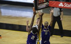 Iowa center Luka Garza goes in for a layup during the Iowa v. Western Illinois basketball game in Carver-Hawkeye Arena on Thursday, Dec. 3, 2020. Garza has scored 30 points so far for Iowa.