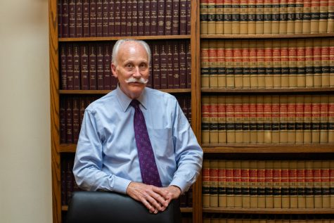 Leon Spies, a criminal defense attorney in Iowa City, poses for a portrait in his office. Spies attended the University of Iowa for both his undergraduate degree and for law school. His firm was originally called Mellon & Spies, but is now called Spies & Pavelich law firm. Spies will be covering the upcoming trial Roy Browning, who
