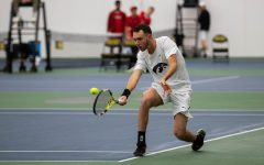 Kareem Allaf hits a backhand during a men's tennis match between Iowa and Cornell at the HTRC on Sunday, Mar. 8, 2020. Iowa defeated Cornell 4-3.