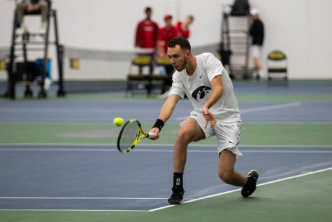 Kareem Allaf hits a backhand during a men