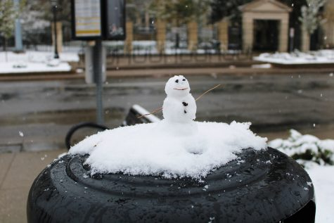 A snowman is seen sitting on top of a trashcan on the Pentacrest on Oct. 19, 2020.