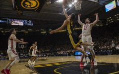 Iowa center Luka Garza shoots a reverse layup during a basketball game between Iowa and Wisconsin on Monday, Jan. 27, 2020 at Carver Hawkeye Arena. The Hawkeyes defeated the Badgers, 68-62.