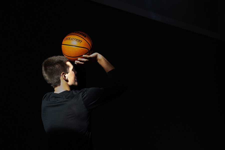 Iowa basketball commit Payton Sandfort prepares to shoot a 3-pointer in his home gym in Waukee.