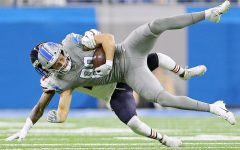 Detroit Lions tight end T.J. Hockenson (88) is tackled by Chicago Bears safety Ha Ha Clinton-Dix (21) after catching a pass in the first quarter of their NFL game at Ford Field in Detroit, on Thursday, November 28, 2019.