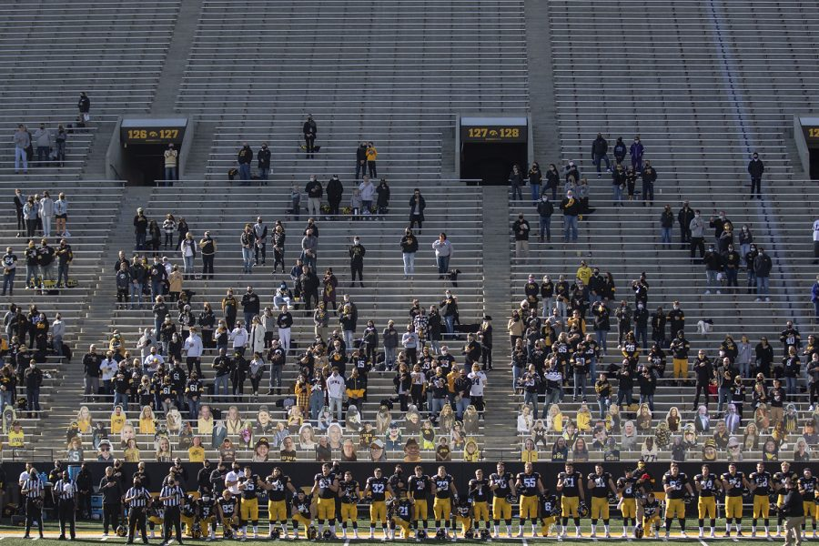 Players kneel and stand for the national anthem before the Iowa v Northwestern football game at Kinnick Stadium on Saturday, Oct. 31, 2020. Head Coach Kirk Ferentz did not kneel for the anthem.The Wildcats defeated the Hawkeyes 21-20.