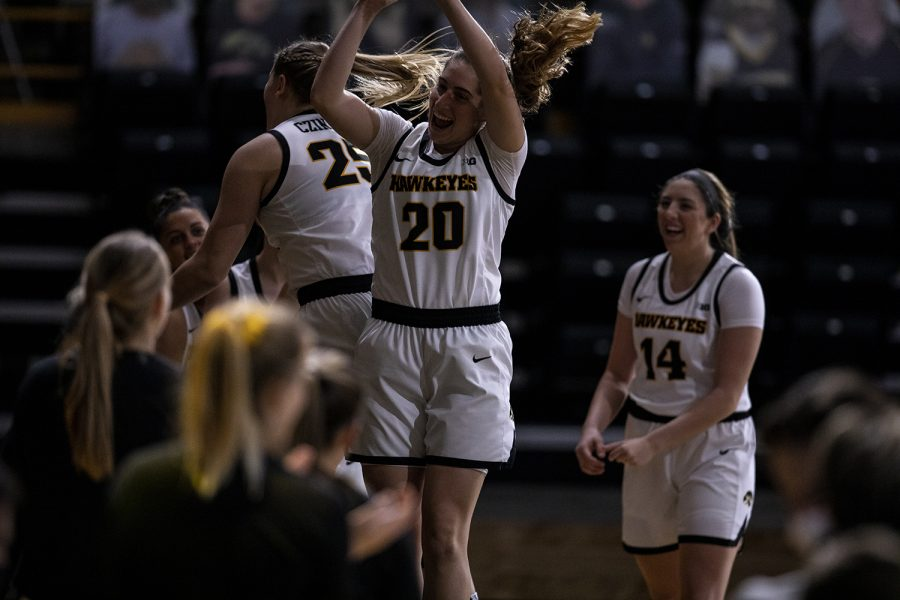 Iowa Guard Kate Martin and Forward Monika Czinano participate in the introductions during a women's basketball game between Iowa and Wisconsin at Carver Hawkeye Arena on Saturday, December 5, 2020. The Hawkeyes defeated the Badgers 85-78.
