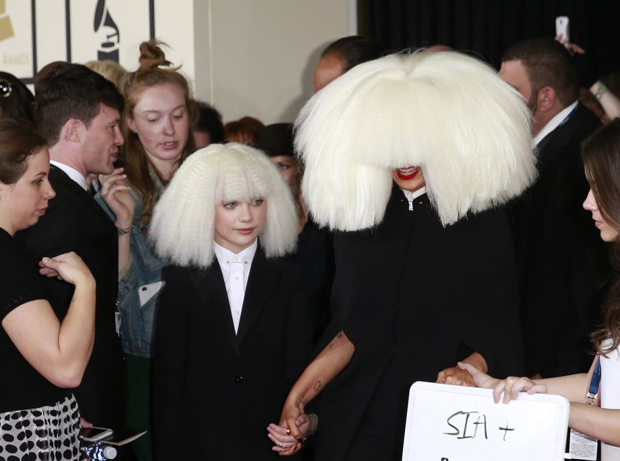 Sia and Maddie arrive at the 57th Annual Grammy Awards at Staples Center in Los Angeles on Sunday, Feb. 8, 2015.