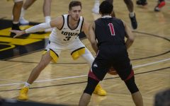 Iowa guard Jordan Bohannon moves to block a pass during a basketball game against Northern Illinois on Sunday, Dec. 13, 2020 at Carver Hawkeye Arena. The Hawkeyes defeated the Huskies, 106-53.
