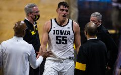 Iowa forward Luka Garza returns to the bench during a menÕs basketball game between Iowa and Iowa State at Carver-Hawkeye Arena on Friday, Dec. 11, 2020. Garza finished with a game-high 34 points.