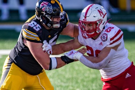 Iowa center Tyler Linderbaum throws a block during a football game between Iowa and Nebraska at Kinnick Stadium on Friday, Nov. 27, 2020. The Hawkeyes defeated the Cornhuskers, 26-20. (Shivansh Ahuja/The Daily Iowan)
