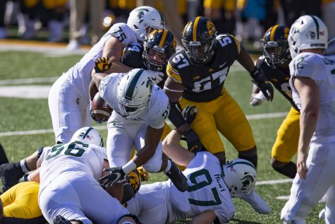 Iowa defensive end Chauncey Golston pursues the running back during a football game between Iowa and Michigan State on November 7, 2020.