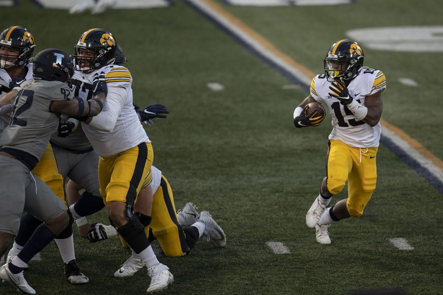Saturday Dec. 5, 2020; Champaign, Illinois, USA; Iowa running back Tyler Goodson (15) moves the ball upfield during the second quarter of the Iowa v. Illinois football game at Memorial Stadium on Saturday, Dec. 5, 2020. Iowa defeated Illinois with a score of 35-21.