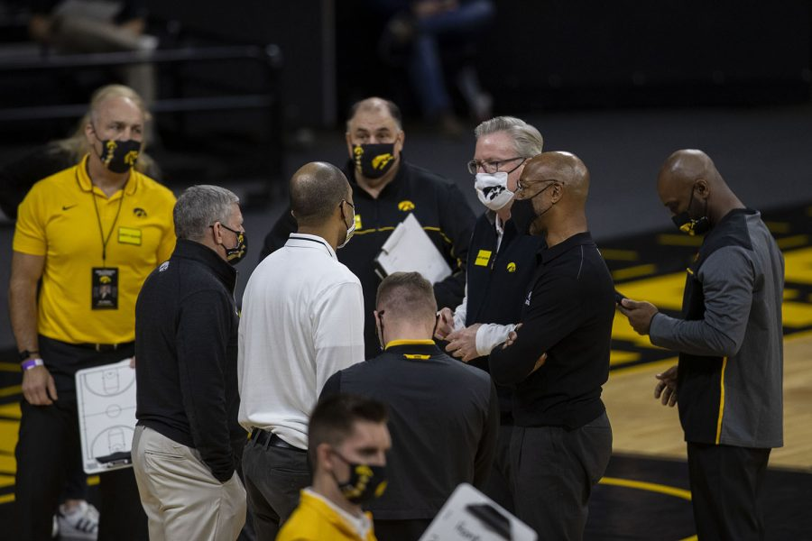 Iowa head coach Fran McCaffery speaks with the assistant coaches during a timeout for the basketball game against Northern Illinois on Sunday, Dec. 13, 2020 at Carver Hawkeye Arena. The Hawkeyes defeated the Huskies, 106-53.