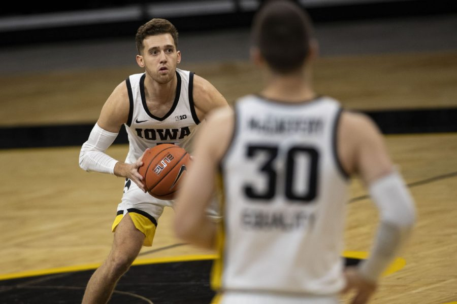 Iowa guard Jordan Bohannon looks to pass during the Iowa men's basketball game against the Southern University Jaguars at Carver-Hawkeye Arena on Friday, Nov. 27, 2020. The Hawkeyes defeated the Jaguars 103-76 in their first game against them since 2017.