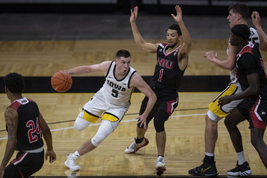 Iowa+guard+CJ+Fredrick+dribbles+the+ball+during+a+basketball+game+against+Northern+Illinois+on+Sunday%2C+Dec.+13%2C+2020+at+Carver+Hawkeye+Arena.+The+Hawkeyes+defeated+the+Huskies%2C+106-53.+