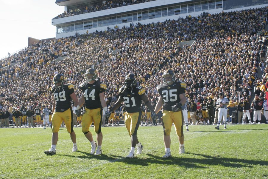 Iowa captains (from left) Bryan Mattison, Mike Humpal, Albert Young and Tom Busch take the field during the coin toss of overtime play against the Michigan State Spartans on Saturday, Oct. 27, 2007.