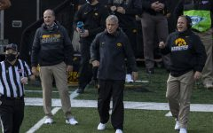 Head Coach Kirk Ferentz and Offensive Coordinator Brian Ferentz are seen without masks during the Iowa v Northwestern football game at Kinnick Stadium on Saturday, Oct. 31, 2020.  The Wildcats defeated the Hawkeyes 21-20. Many Iowa Coaches wore Gaitor face guards, which the CDC has suggested is not as effective against the spread of COVID-19 as a regular mask.