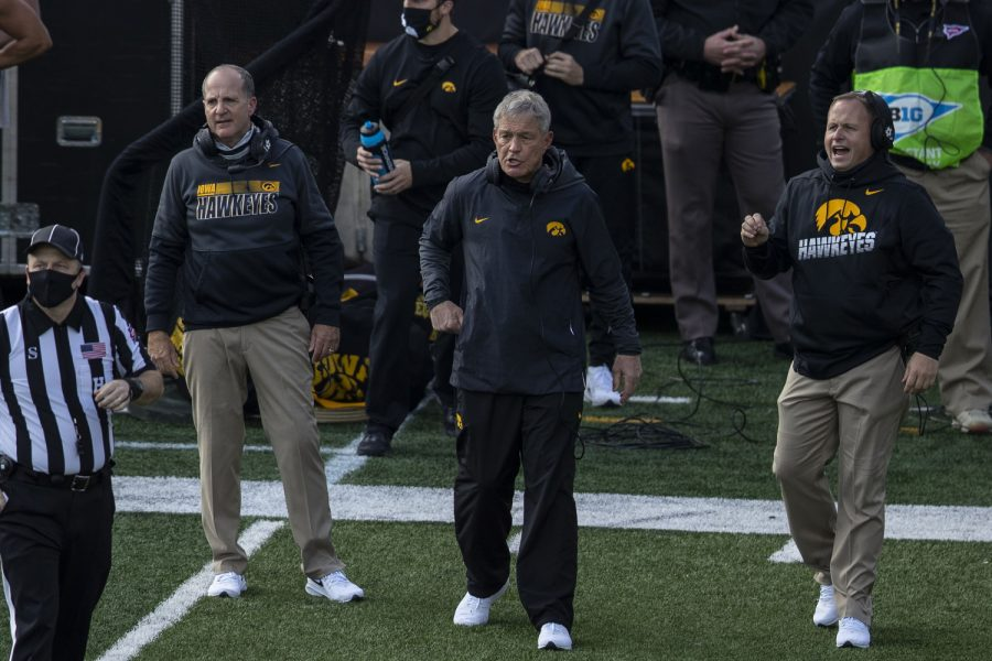 Head+Coach+Kirk+Ferentz+and+Offensive+Coordinator+Brian+Ferentz+are+seen+without+masks+during+the+Iowa+v+Northwestern+football+game+at+Kinnick+Stadium+on+Saturday%2C+Oct.+31%2C+2020.++The+Wildcats+defeated+the+Hawkeyes+21-20.+Many+Iowa+Coaches+wore+Gaitor+face+guards%2C+which+the+CDC+has+suggested+is+not+as+effective+against+the+spread+of+COVID-19+as+a+regular+mask.