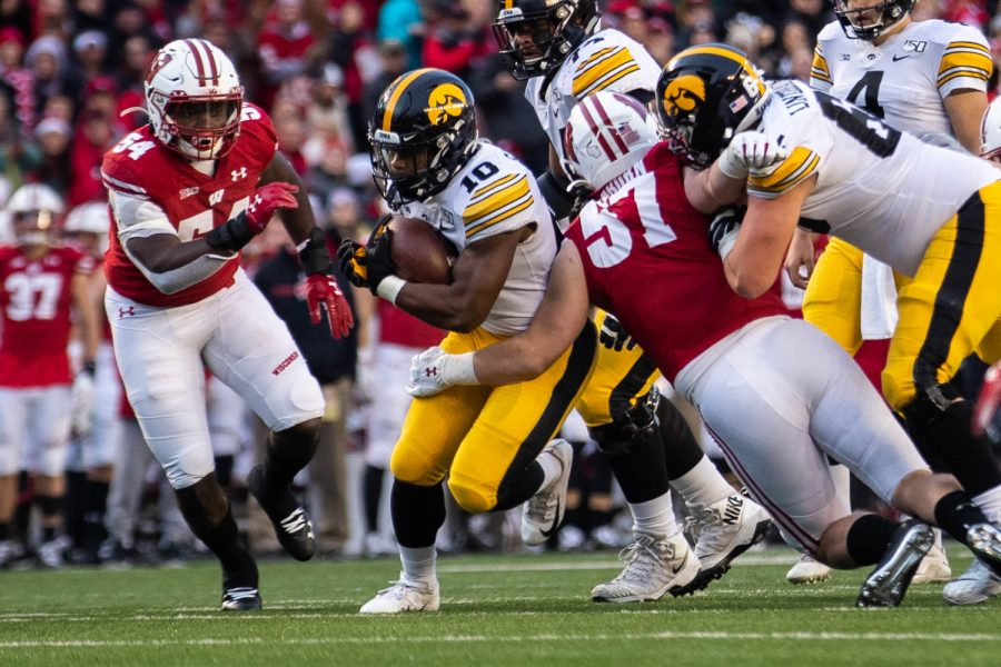 Iowa running back Mekhi Sargent runs down the middle during a game against Wisconsin at Camp Randall Stadium on Saturday, November 9, 2019. The Hawkeyes were defeated by the Badgers 24-22. Sargent ran for a total of 21 yards.