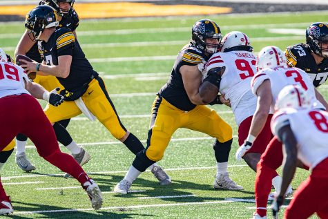 Iowa center Tyler Linderbaum throws a block during a football game between Iowa and Nebraska at Kinnick Stadium on Friday, Nov. 27, 2020. The Hawkeyes defeated the Cornhuskers, 26-20.