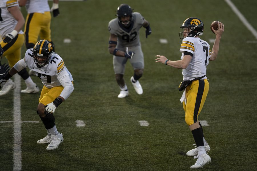 Saturday Dec. 5, 2020; Champaign, Illinois, USA; Iowa quarterback Spencer Petras (7) overthrows a pass towards the endzone during the second quarter of the Iowa v. Illinois football game at Memorial Stadium.