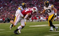 Iowa defensive back Geno Stone makes a tackle during a game against Wisconsin at Camp Randall Stadium on Saturday, November 9, 2019. The Hawkeyes were defeated by the Badgers 24-22.  The Hawkeye defense had a total of 67 tackles.