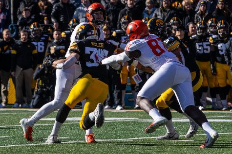 Iowa line backer Kristian Welch rushes Illinois quarter back Brandon Peters during the game against Illinois on Saturday, November 23, 2019. The Hawkeyes defeated the Fighting Illini 19-10.