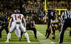 Iowa quarterback Nate Stanley surveys the defense during a football game between Iowa and Minnesota at Kinnick Stadium on Saturday, Nov. 16, 2019. Stanley was sacked twice in the Hawkeyes' win.