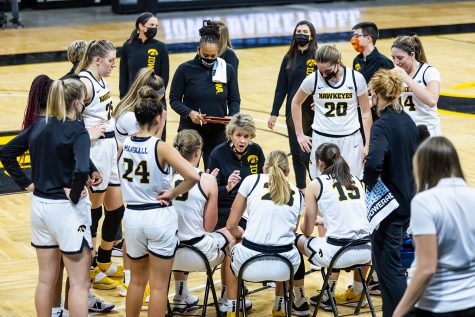 Iowa Hawkeye Head Coach Lisa Bluder talks with the team during halftime in the Iowa Hawkeyes Women's Basketball season opener against Northern Iowa on Nov. 25, 2020. The Hawkeyes defeated Northern Iowa 96-81.