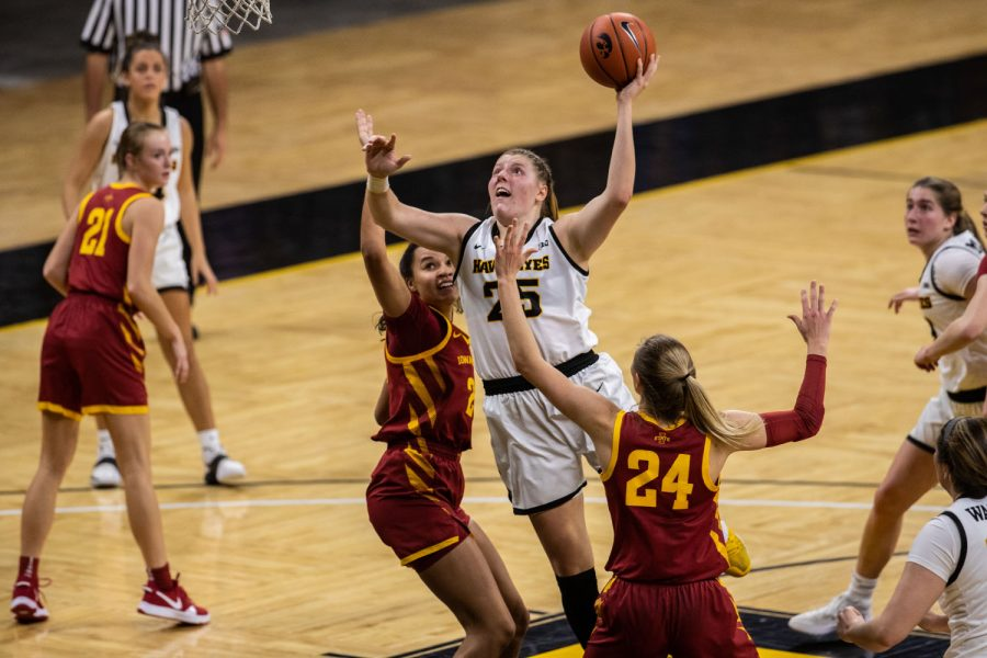 Iowa player Monika Czinano goes up for a basket during a women's basketball game between Iowa and Iowa State at Carver-Hawkeye Arena on Wednesday, Dec. 9, 2020. The Hawkeyes defeated the Cyclones in a close game, 82-80.
